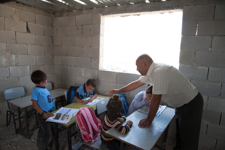 A teacher leads a class at the school in the village of Khirbet al Fakheit. (photo: Ryan Rodrick Beiler/Activestills.org)