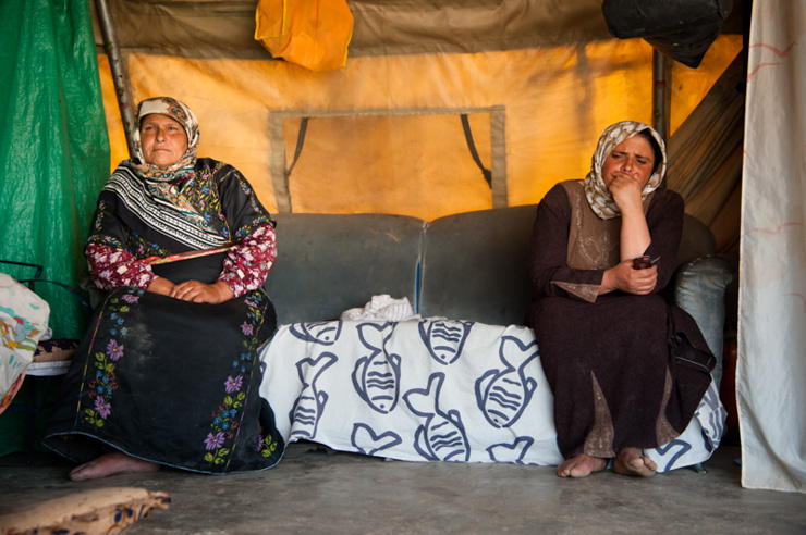 Women sit in their tent home in Khirbet at Tabban, a village of 11 families. (photo: Ryan Rodrick Beiler/Activestills.org)
