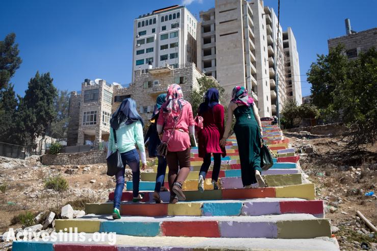 Palestinian women climb painted stairs in the city center of Ramallah, West Bank, September 23, 2013. (photo: Oren Ziv/Activestills.org)