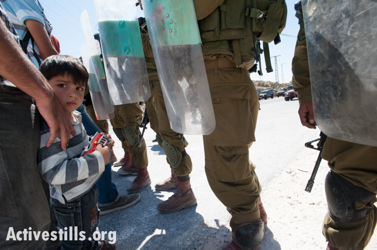 PHOTOS: Israeli army arrests Palestinian activist at nonviolent demonstration