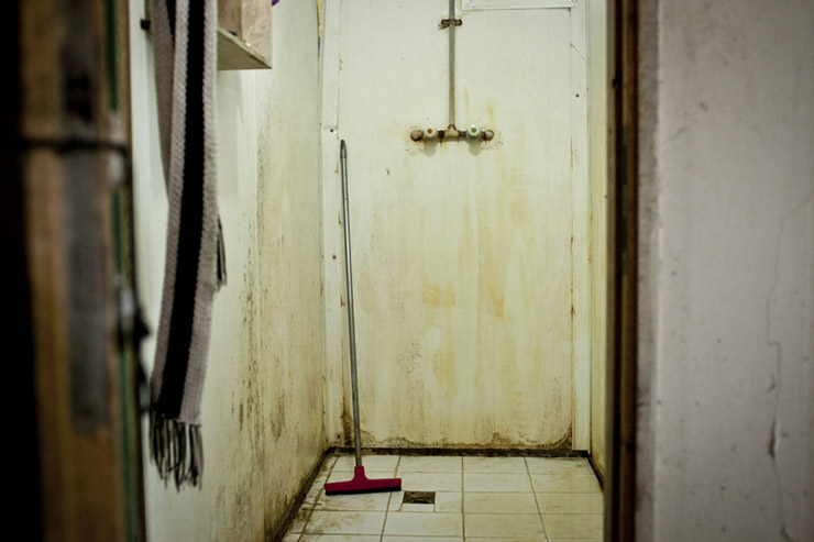 A workers' bathroom at a workers' residence, Kfar Varburg, August 31, 2013. (Shiraz Grinbaum/Activestills.org)