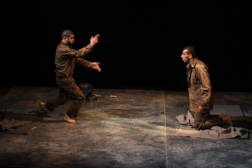 "Jenin Freedom Theatre actors Ahmed Alrakh (left) and Faisal Abu Alhayjaa perform a scene from Athol Fugard's ""The Island."" (Courtesy of Jenin Freedom Theatre)"