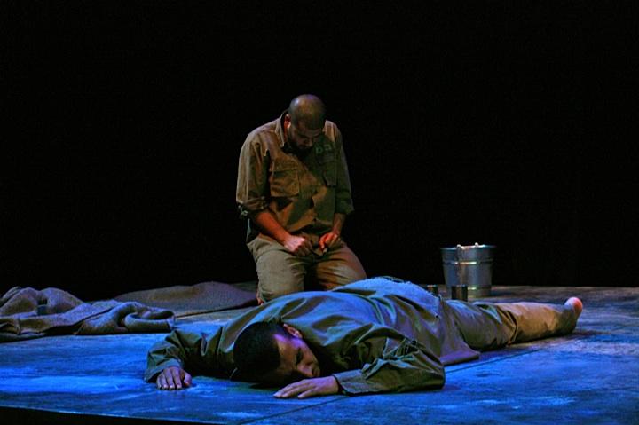 "Jenin Freedom Theatre actors Faisal Abu Alhayjaa (foreground) and Ahmed Alrakh perform Athol Fugard's ""The Island."" (Courtesy of Jenin Freedom Theatre)"
