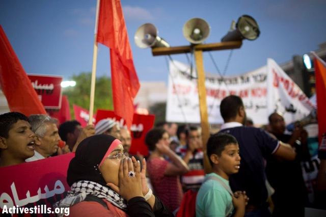 Demonstrator at the Anti-Prawer demonstration in Tel Aviv (Oren Ziv / Activestills)