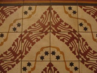 Hand-painted floor tiles in an old, pre-state home in Bethlehem. The design depicts the Star of David and a menorah. (Photo: Mya Guarnieri)