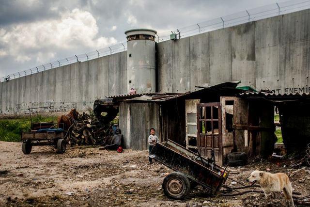 """Wall"". A small family's hut in Qalqilia where the wall goes through (Hamde Abu Rahma, from the book)"