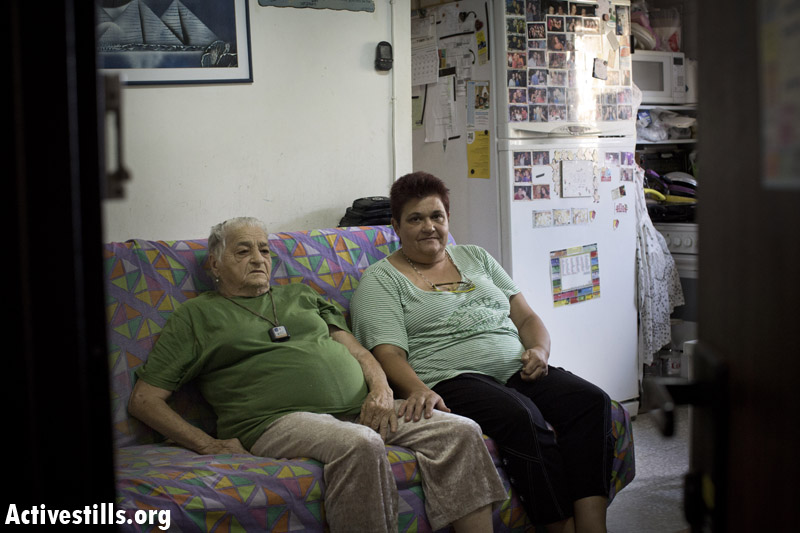 Debora and Miryam, daughter and mother, both served in the municipality of Ramat Gan, which gave them the apartment 25 years ago. (Oren Ziv/Activestills.org)