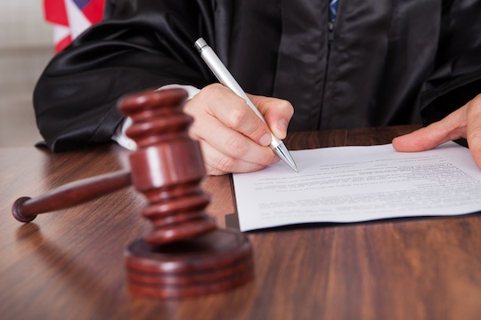Illustrative photo of a judge signing a document. (Photo: Shutterstock.com)