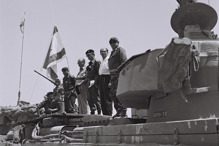 Prime Minister Levi Eshkol (second from left) and Min. Menachem Begin (second from right) watch an army parade in occupied Sinai, a number of days after the Six Day War, June 13, 1967. (Photo: Moshe Milner/GPO)