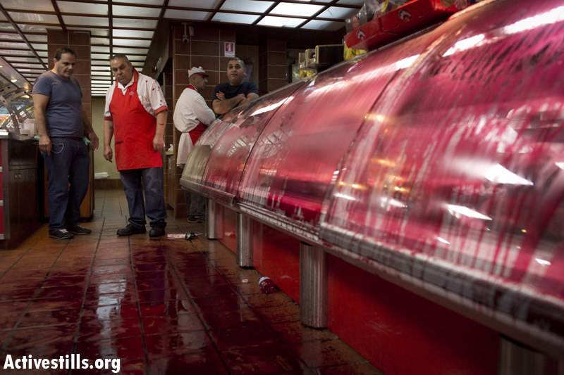 PHOTOS: Animal rights activists arrested in Israeli meat factory store