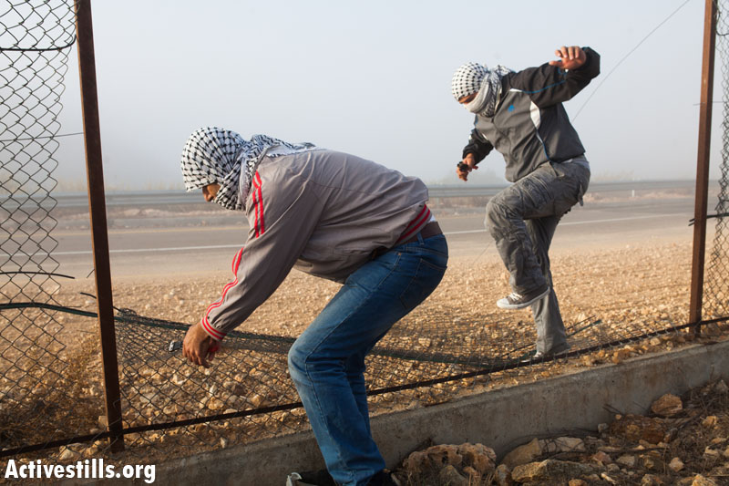 PHOTOS: Palestinians destroy separation barrier in two West Bank villages