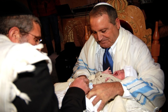 A Jewish child is circumcised in a traditional Brit Mila ceremony (Illustrative photo by Shutterstock.com)
