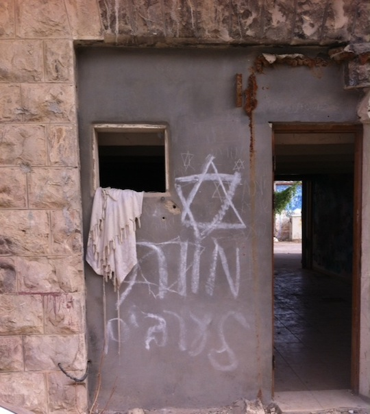 """Death to Arabs"" sprayed on door of door near Hebron's wholesale market. (Photo: Avner Gvaryahu, Breaking the Silence)"