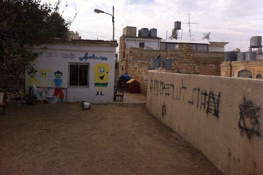 "Palestinian kindergarten in Hebron vandalized with ""Death to Arabs"" graffiti (Photo: Avner Gvaryahu, Breaking the Silence)"