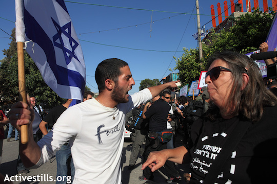 A right-wing Israeli activist yells at a left-wing Israeli activist in East Jerusalem. (Photo: Anne Paq/Activestills.org)