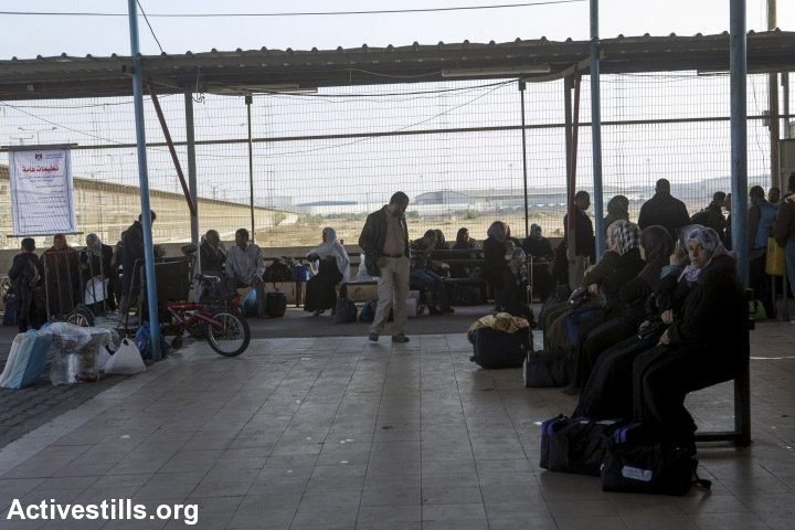 Palestinians wait at the Gaza side of the Erez crossing, Beit Hanoun, Gaza Strip, November 19, 2013. Erez is the only point of crossing for persons between Israel and the Gaza Strip, and with the tightening of the siege, a very low number of Palestinians are able to obtain permits. (photo: Anne Paq/Activestills.org)