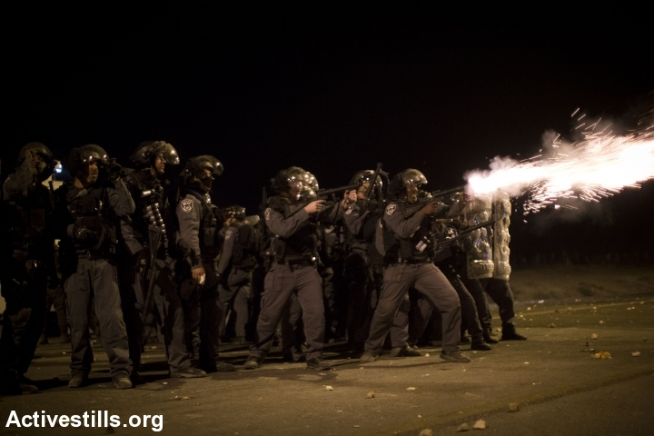 Police shots tear gas at protestors at head level during Day of Rage protest against the Prawer-Begin Plan, near the twon of Hura, Israel, November 30, 2013.