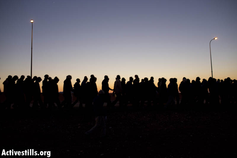 African Asylumseekerstake part in a protest march on the highway from Be'er Sheva in southernIsrael on their way to Jerusalem on December 16, 2013 after they fled a detentioncentrein the south where they were being held. (photo: Activestills.org)