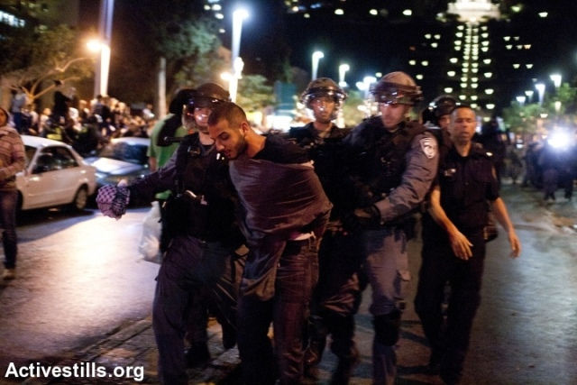 Haifa anti-Prawer demonstrator arrested on the 'day of rage,' November 30, 2013. (Photo: Activestills)
