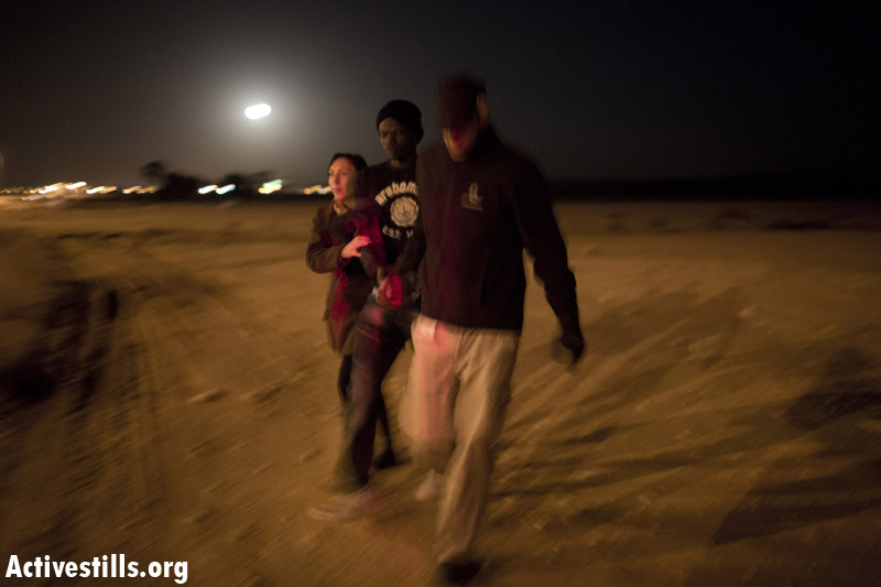 An African asylum seeker is arrested after marching during the second March for Freedom from the Holot detention center towards Be'er Sheva, Negev, December 19, 2013. (Activestills.org)