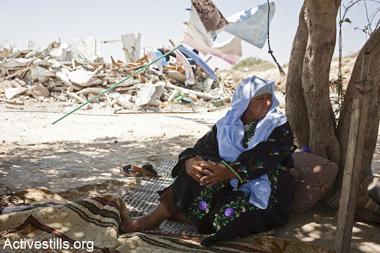 Sanda Abulkian sits outside her demolished house in the unrecognized village of Atir on July 12, 2013. The Abulkian house has demolished four times already, three of them during 2013. (Photo: Keren Manor/Activestills.org)