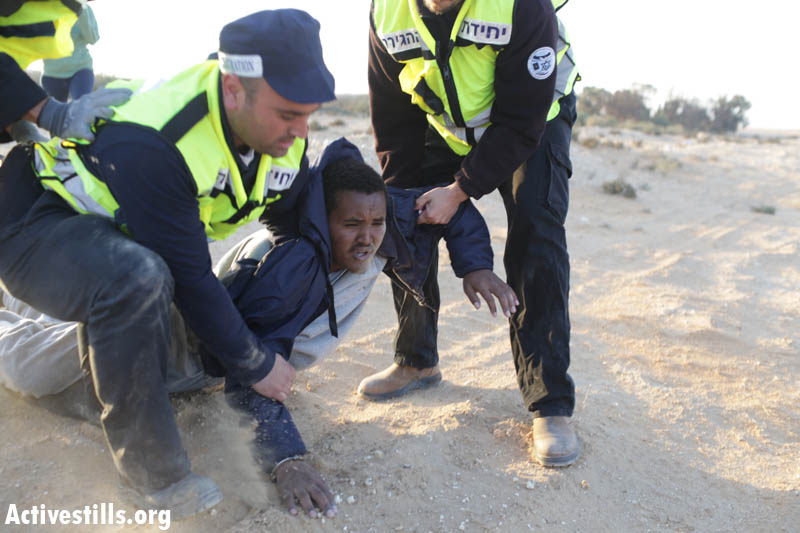 "Immigration officers arrest an asylum seeker during the second ""March for Freedom"" in the Negev desert. (photo: Oren Ziv/Activestills.org)"