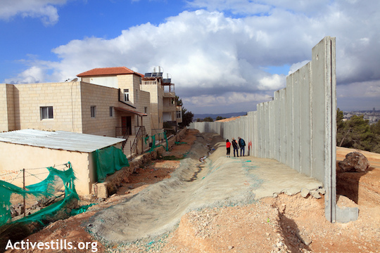 The separation wall being built in al-Walaja, December 7, 2010. Once completed, the wall will completely surround the village. (Photo by Anne Paq/Activestills.org)