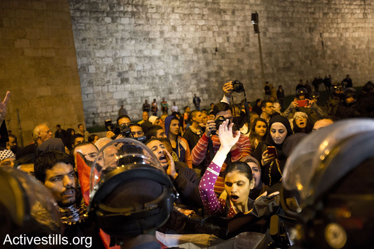"""Activists are blocked by Israeli police forces during the """"Day of Rage"""" protest against the Prawer-Begin Plan, Bab A-Zahara, East Jerusalem, November 30, 2013."""