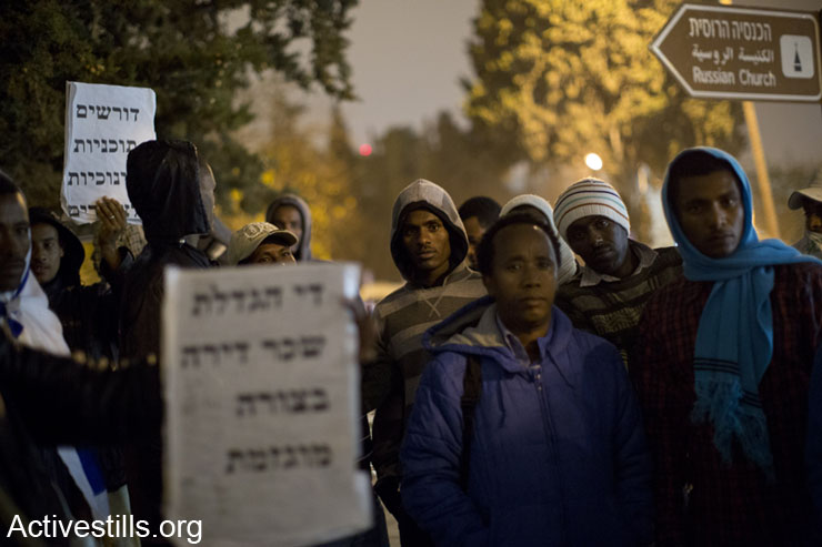 Ethiopians await outside a police station in central Jerusalem for the release of Ethiopian activists arrested during a demonstration earlier in the day, Jerusalem, December 3, 2013. A demonstration of the Ethiopian community took place calling for housing and better jobs for their community.