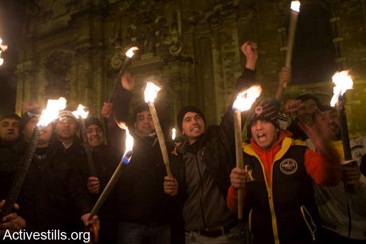 Afghan asylum seekers march with torches demanding protection and decent living conditions, Brussels, Belgium, December 4, 2013. Hundreds of Afghan asylum seekers use a church as a shelter living in difficult conditions. Without papers, they cannot work or find decent housing. There are around 2.7 million Afghans who continue to live in exile and some 450,000 who are internally displaced. Belgium has been involved in the Afghan conflict a decade.