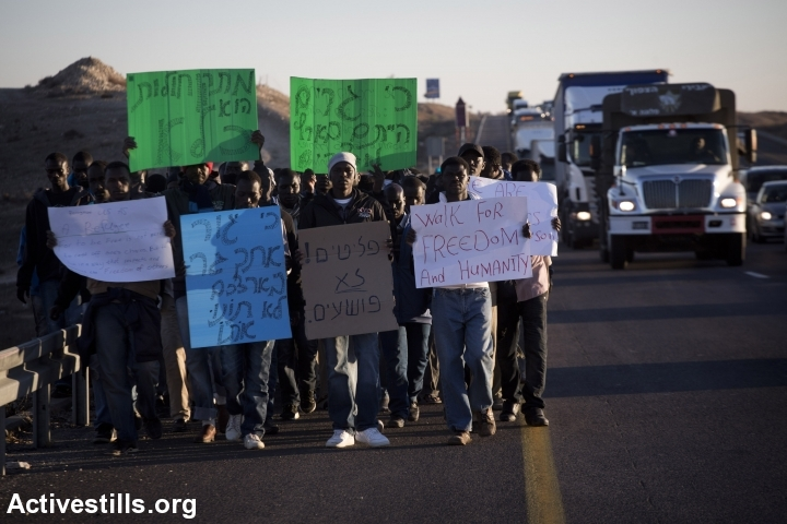 African Asylum seekers take part in a protest march on the highway from Beer Sheva in southern Israel on their way to Jerusalem on December 16, 2013, after they fled a detention center in the south where they were being held. (Oren Ziv/Activestills.org)