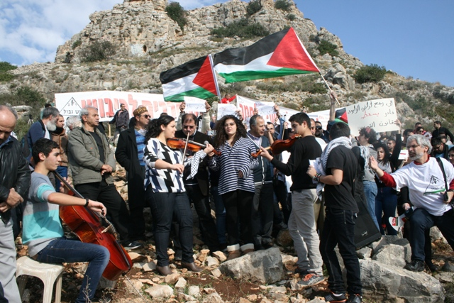 Demonstrators chanted in Arabic and Hebrew against the draft, occupation (Haggai Matar)