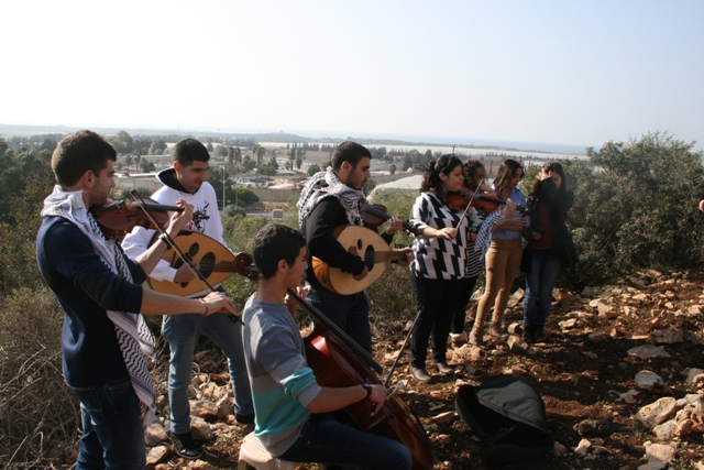 Sa'ad's siblings and friends playing to lift his spirits. In the background: Prison 6 (Haggai Matar)