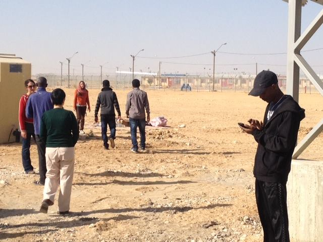 Asylum seekers and their visitors outside the Holot 'open prison.' (photo: Assaf Chen)