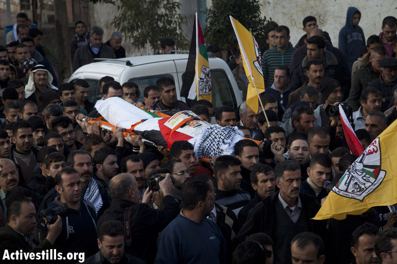 Palestinians from the village of Qadum carry the body of Said Jasir, who died after inhaling tear gas shot by Israeli soldiers. (Activestills)