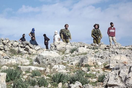 IDF stands by masked settlers in Burin (Photo: Munir Kadus, Yesh Din)