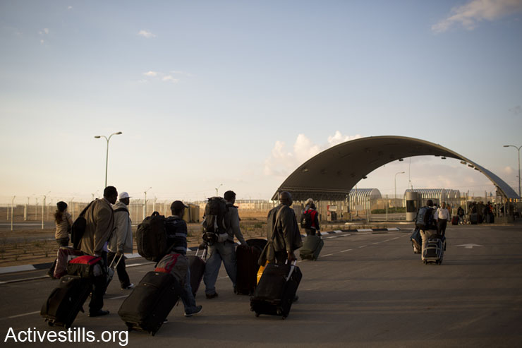 African asylum seekers walk into the Holot detention center in Israel's southern Negev desert, on February 17, 2014.