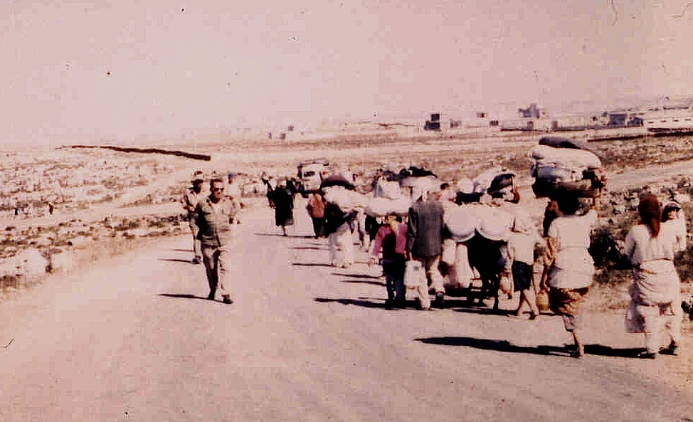 IDF soldiers expel the residents of Imwas from their village during the 1967 Six Day War. (photo: www.palestineremembered.com)