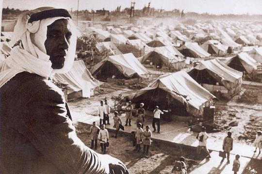 A Palestinian refugee looks over the Jaramana Refugee Camp in Damascus, 1948. (Author unknown)