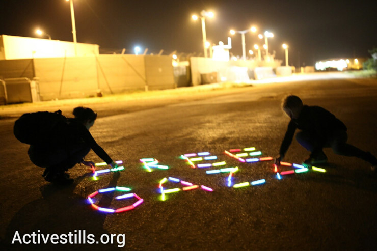 Female Israeli anti-occupation activists protest the siege on Gaza at the Erez Crossing on International Women's Day. (photo: Activestills)