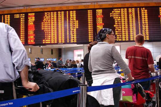 Passengers at Israel's Ben-Gurion Airport (Photo by ChameleonsEye / Shutterstock.com)