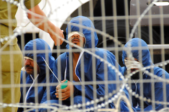 Illustrative photo of Palestinian prisoners in an Israeli military prison (By ChameleonsEye / Shutterstock.com)