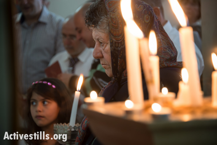 On Easter Monday, generations of the displaced Palestinian village of Iqrit celebrate mass in the town's church, the only building to remain standing. April 21, 2014. (Activestills.org)