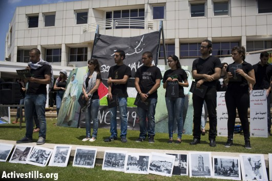 Palestinian students lead a Nakba commemoration ceremony at Tel Aviv University. (photo: Activestills.org)