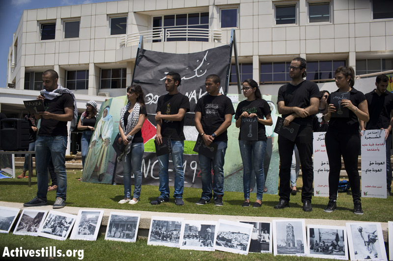 Palestinian students lead a Nakba commemoration ceremony at Tel Aviv University. (photo: Activestills.org)