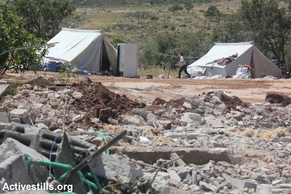Two Palestinian families moved to live in tents next to their demolished houses in Khirbet Twaiel, West Bank, April 30, 2014. (Photo: Ahmad al-Bazz/Activestills.org)