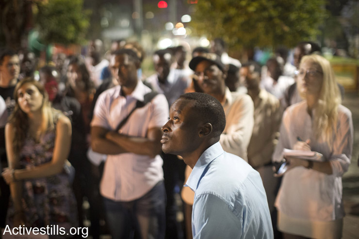 Mutasim Ali, an African Asylum seeker, speaks to friends and activists, two days before he is due to arrive to the Holot detention center, Tel Aviv, May3rd, 2014. Ali is one of the organizers of the Asylum seekers' struggle in Israel.