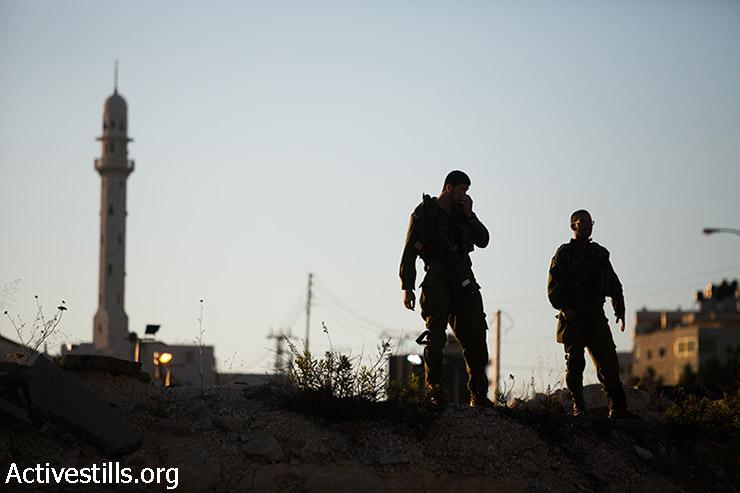 Israeli soldiers surround the West Bank city of Hebron, seen on June 15, 2014. (Yotam Ronen/Activestills.org)