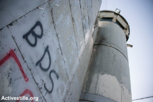 BDS graffiti on Israeli separation wall, Bethlehem, West Bank, June 17, 2014. (Photo by Ryan Rodrick Beiler/Activestills.org)