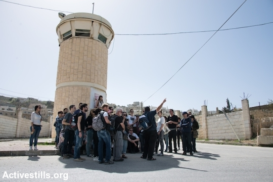 Breaking the Silence leads a tour group in the occupied city of Hebron, West Bank, March 7, 2014. (Photo: Ryan Rodrick Beiler/Activestills.org)